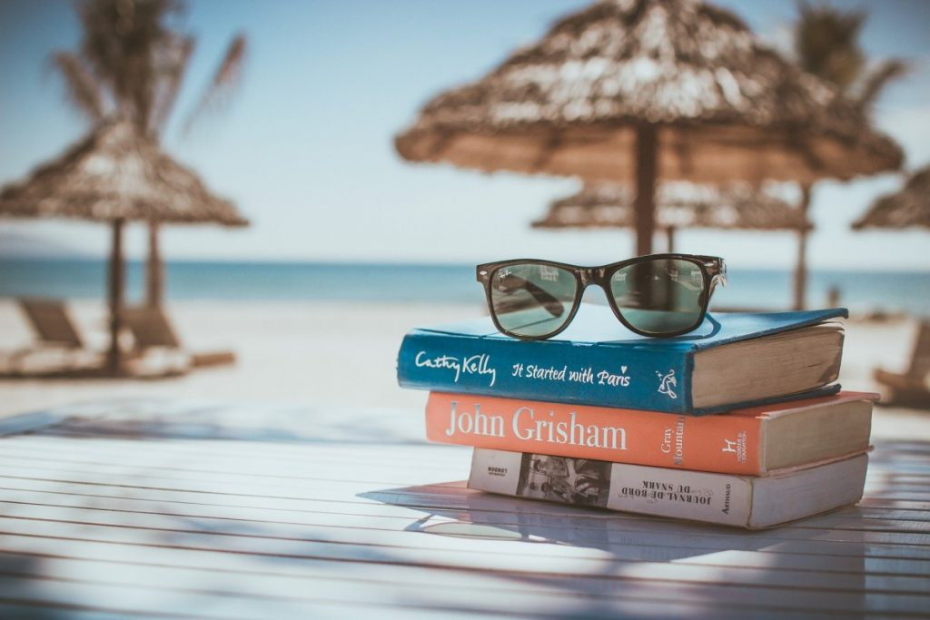 Packing List: Books and glasses on the beach