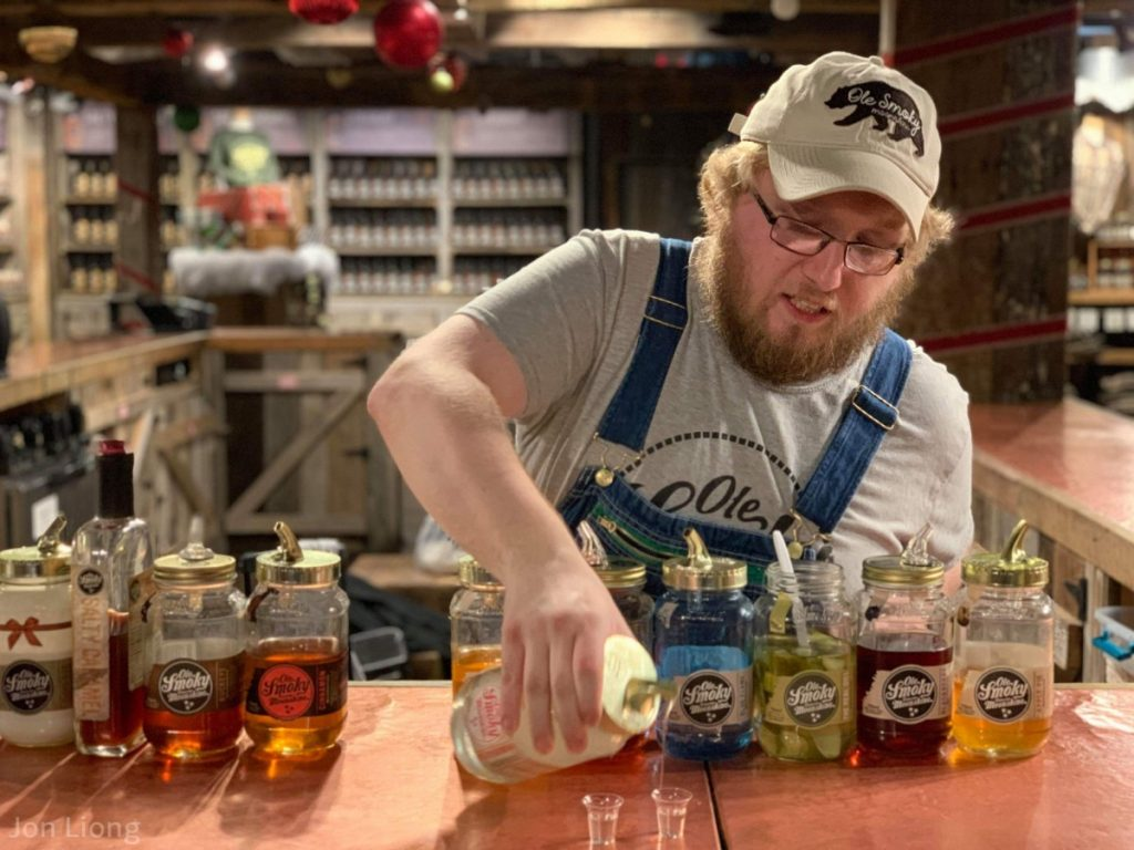 Nutter pouring us a shot of Ole Smoky Moonshine